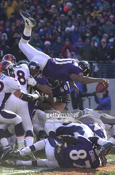 Jamal Lewis of the Baltimore Ravens goes over the top for a first quarter touchdown to give the Ravens a 70 lead over the Denver Broncos during the...