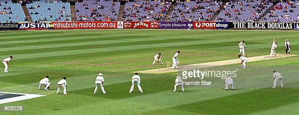 Jason Gillespie of Australia bowls whilst the entire team are in close fielding, in the 4th test match between Australia and the West Indies, played...