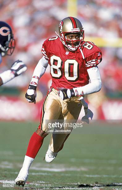 Jerry Rice of the San Francisco 49ers looks to the side while running during the game against the Chicago Bears at the 3Com Park in San Francisco...