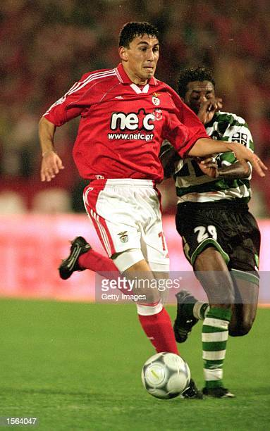 Joao Tomas of Benfica holds off Cesar Prates of Sporting Lisbon during the Portuguese League match at the Stadium of Light in Lisbon Portugal Pic...