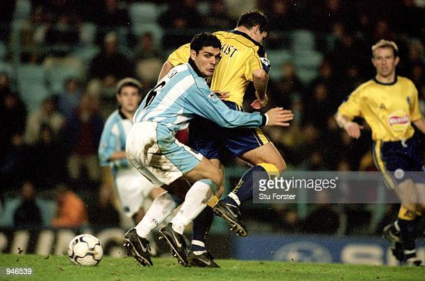 John Aloisi of Coventry City has his route to goal blocked by Phil Gilchrist of Leicester City during the FA Carling Premiership match played at...