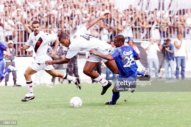 Junior Baiano of Vasco is tackled by Ailton of Sao Caetano during the Vasco de Gama v Sao Caetano Jaoa Havelange Cup Final SecondLeg match played at...