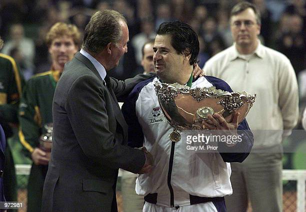 King Juan Carlos of Spain presents the Davis Cup trophy to Spanish captain Javier Duarte after the fourth rubber between Juan Carlos Ferrero of Spain...
