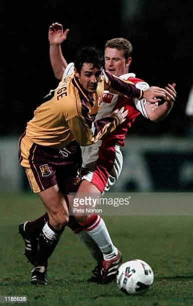 Mark Robins of Rotherham United challenges Dave Savage of Northampton Town during the AXA sponsored FA Cup 2nd round match played at Millmoor in...