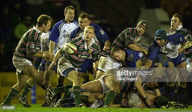 Martin Johnson of Leicester feeds the ball back to team mate Pat Howard during the Zurich Premiership match between Leicester v Bath at Welford Road...