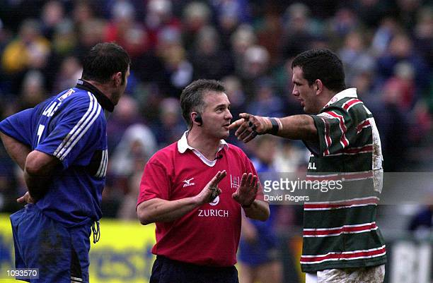 Martin Johnson the Leicester captain together with Ben Clarke the Bath captain are spoken to by referee Chris White during an often ill tempered game...