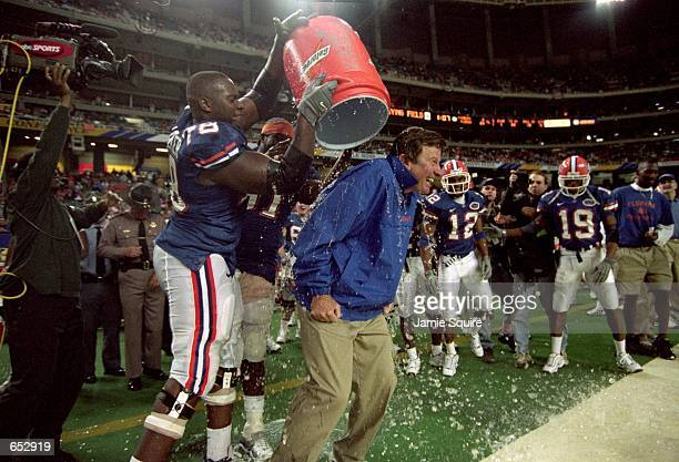 Menyatta Walker of the Florida Gators dumps ice on Head Coach Steve Spurrier after the game against the Auburn Tigers at the Georgia Dome in Atlanta...