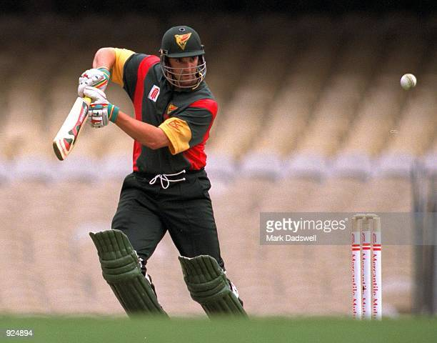 Michael Di Venuto of Tasmania plays a square drive during the Mercantile Mutual Cup match between the Victorian Bushrangers and the Tasmanian Tigers,...