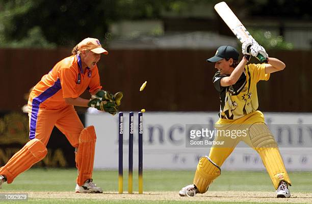 Netherlands wicketkeeper Rowan Milburn attempts to stump Lisa Keightley of Australia during the Australia v Netherlands match in the 2000 CricInfo...