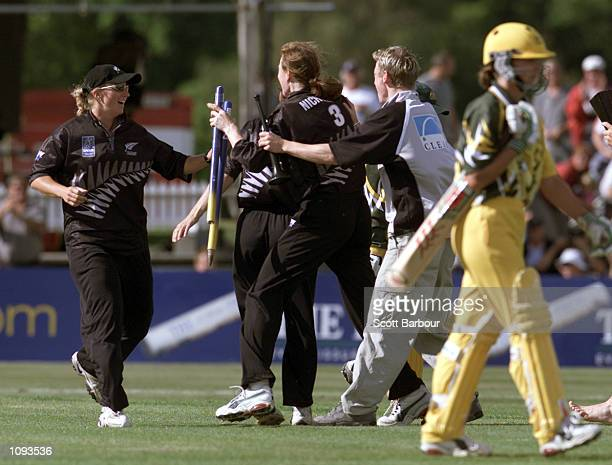 New Zealand bowler Claire Nicholson and players celebrate as the Australian batsman leave the field after the New Zealand v Australia match in the...