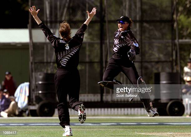 New Zealand bowler Claire Nicholson and wicketkeeper Rebecca Rolls celebrate the last wicket to fall of Charmaine Mason of Australia after the New...