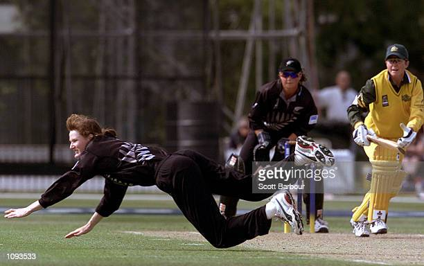New Zealand bowler Claire Nicholson dives for the ball as Australian batsman Charmaine Mason looks on during the New Zealand v Australia match in the...