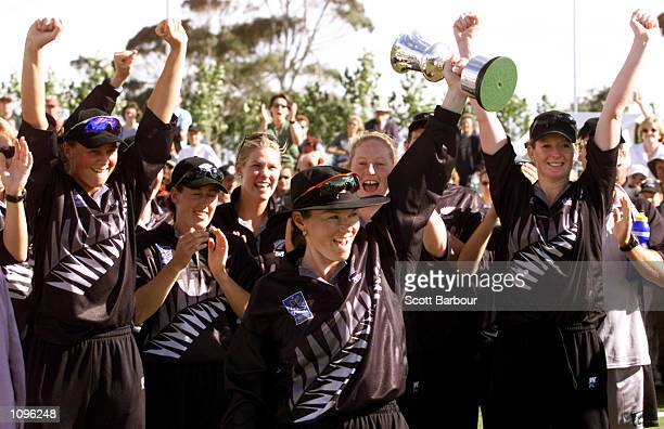 New Zealand captain Emily Drumm holds the World Cup aloft as her team mates celebrate after the New Zealand v Australia match in the Final of the...
