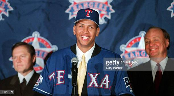 Newly signed Texas Ranger Alex Rodriguez center is introduced to the media by club owner Tom Hicks right and Rodriguez' agent Scott Boras during a...