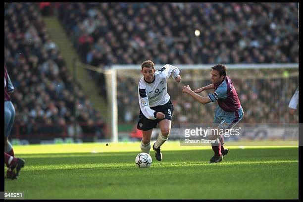 Nicky Butt of Manchester United evades Gareth Southgate of Aston Villa during the FA Carling Premiership match at Villa ParkBirminghamEngland...