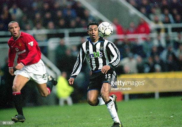 Nolberto Solano of Newcastle United races clear of Mikael Silvestre of Manchester United during the FA Carling Premiership match played at St James...