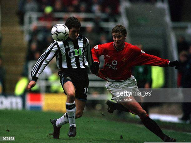 Ole Gunnar Solskjaer of Man Utd clashes with Andrew Griffin of Newcastle during the Newcastle United v Manchester United FA Carling Premiership match...