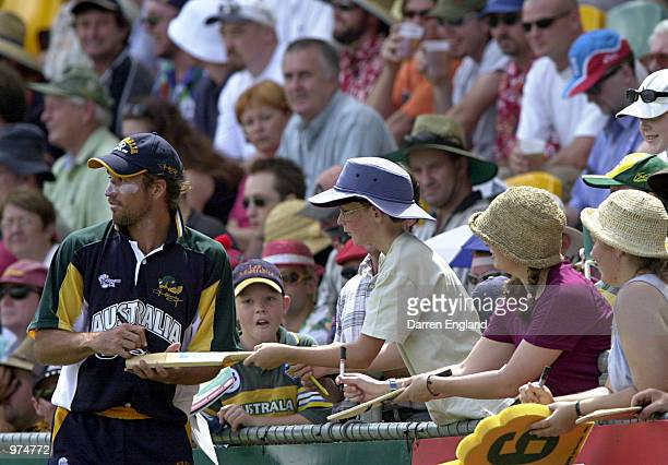 Pat Rafter signs autographs for fans while fielding during the Ian Healy Testimonial Cricket match played between Ian Healy's Australian Eleven and...