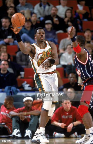 Patrick Ewing of the Seattle SuperSonics passes the ball during the game against the Houston Rockets at Key Arena in Seattle Washington The Rockets...