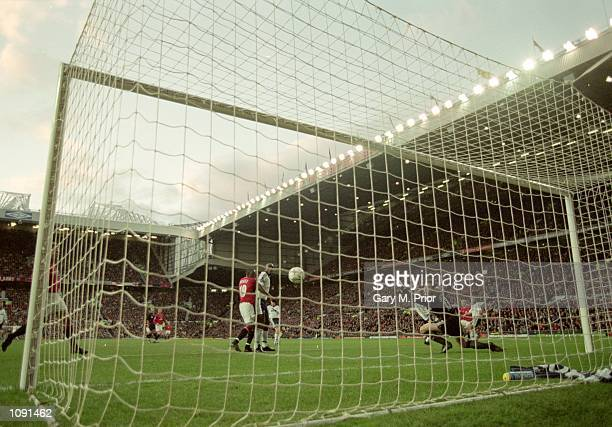 Paul Scholes of Manchester United scores during the FA Carling Premiership match against Tottenham Hotspur played at Old Trafford in Manchester...