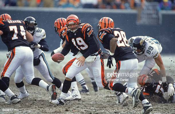 Quarterback Scott Mitchell of the Cincinnati Bengals moves with the ball during the game against the Jacksonville Jaguars at the Paul Brown Stadium...