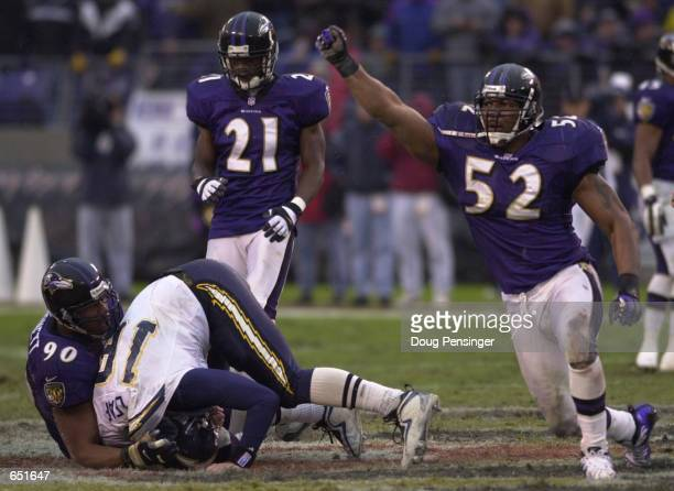 Ray Lewis of the Baltimore Ravens celebrates as teammate Rob Burnett sacks Ryan Leaf of the San Diego Chargers at PSINet Stadium in Baltimore...