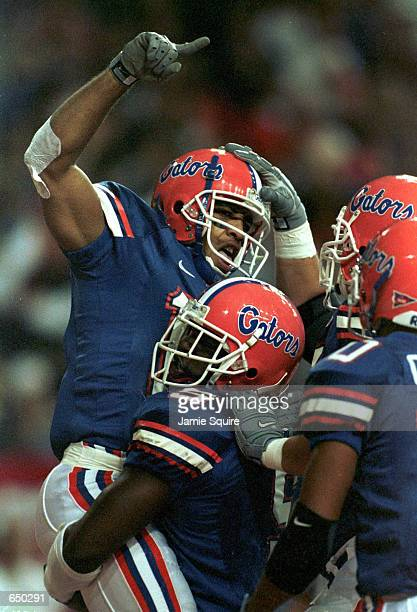 Reche Caldwell of the Florida Gators celebrates after scoring a touchdown during the S.E.C. Championship against the Auburn Tigers at the Georgia...