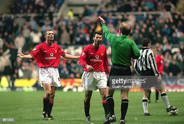 Roy Keane and Ryan Giggs of Manchester United protest during the FA Carling Premiership match against Newcastle United played at St James Park in...