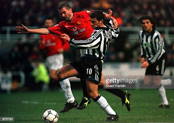 Roy Keane of Man Utd battles with Christian Bassedas of Newcastle during the Newcastle United v Manchester United FA Carling Premiership match at St...