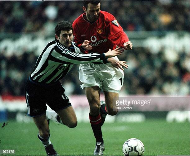 Ryan Giggs of Man Utd clashes with Andrew Griffin of Newcastle before being brought down for the penalty during the Newcastle United v Manchester...