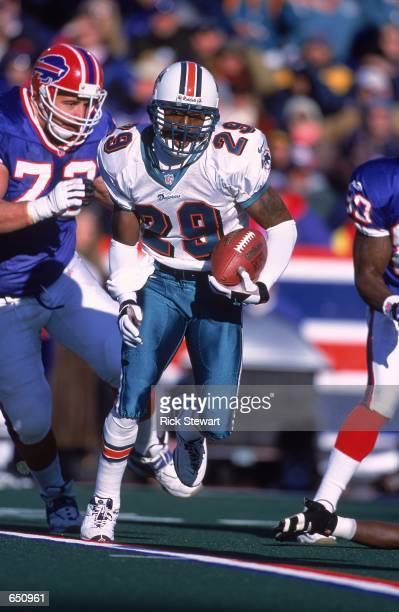 Sam Madison of the Miami Dolphins moves with the ball during the game against the Buffalo Bills at the Ralph Wilson Stadium in Orchard Park New York...