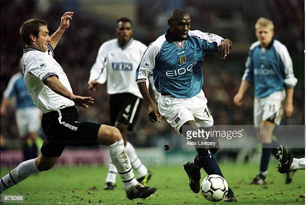 Shaun Goater of Man City beats Horacio Carbonari of Derby during the Premier League match between Manchester City and Derby County at Maine Road...