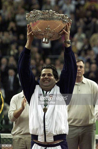 Spanish captain Javier Duarte holds aloft the Davis Cup after the fourth rubber between Juan Carlos Ferrero of Spain and Lleyton Hewitt of Australia...