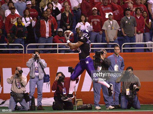 Teddy Johnson of Northwestern makes a leaping touchdown catch against Nebraska in the first quarter during the Alamo Bowl at the Alamodome in San...