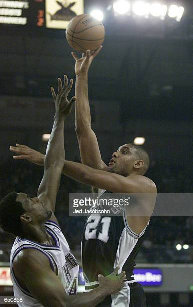 Tim Duncan of the San Antonio Spurs shoots over Chris Webber of the Sacramento Kings at Arco Arena in Sacramento California DIGITAL IMAGE> Mandatory...