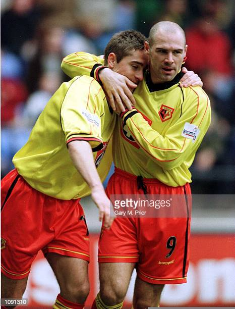 Tommy Smith of Watford is congratulated by Tommy Mooney after scoring the first goal during the Bolton Wanderers v Watford Nationwide Division One...