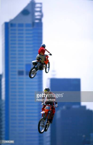 Two competitors in the Freestyle MotoCross gets some air during the mornings practice session for the Planet X Summer Xtreme Games which begin...