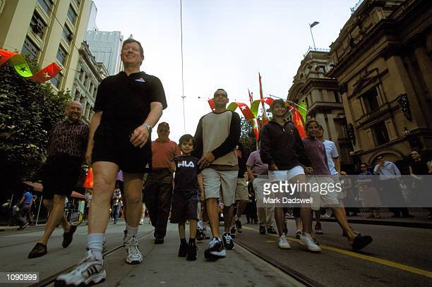 Wayne Jackson CEO of the Australian Football League begins the Reconciliation Walk at the Melbourne Town Hall with Essendon's Michael Long and...