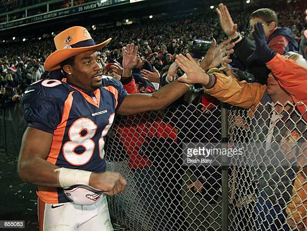 Wide receiver Rod Smith of the Denver Broncos gives fans high fives as he runs around the stadium after the game against the San Francisco 49ers at...