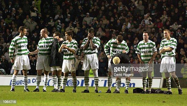 A dejected Celtic team line up during penalties at the UEFA Cup third Round second Leg match between Celtic and Valencia at Celtic Park Glasgow...