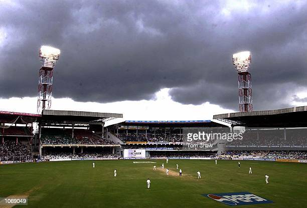 General view of the ground with a dark raincloud above during the third day of the 3rd test between India and England at the Chinaswamy Stadium,...