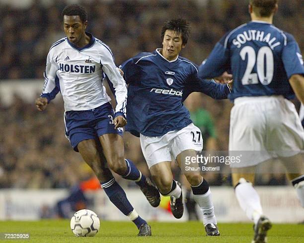 Akinori Nishizawa of Bolton Wanderers challenges Anthony Gardner of Tottenham Hotspur during the Worthington Cup Fifth Round match between Tottenham...