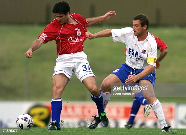 Aljosa Asanovic of Sydney United is tackled by Andrew Marth of the Knights during the round 9 NSL match between Sydney United and Melbourne Knights...