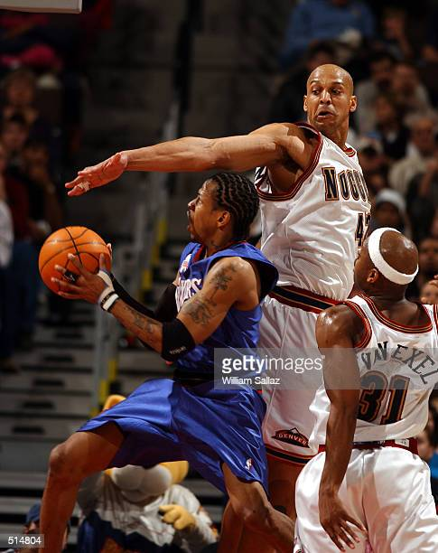 Allen Iverson of the Philadelphia 76ers drives around Scott Williams of the Denver Nuggets at the Pepsi Center in Denver Colorado DIGITAL IMAGE NOTE...
