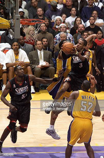 Allen Iverson of the Philadelphia 76ers tries to get to the basket past Samaki Walker and the rest of the Los Angeles Lakers during the second half...