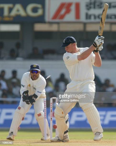 Andrew Flintoff of England is bowled by Anil Kumble of India during the fourth day of the 2nd Test between England and India at the Sardar Patel...