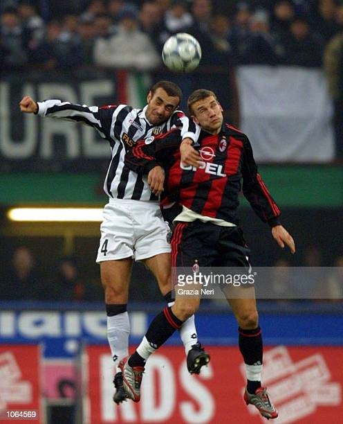 Andriy Shevchenko of AC Milan and Paolo Montero of Juventus in action during the Serie A 14th Round League match between AC Milan and Juventus played...
