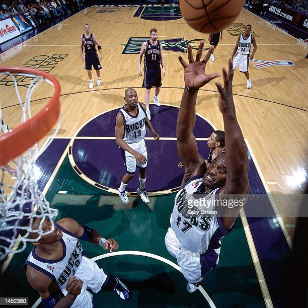 Anthony Mason of the Milwaukee Bucks goes up for a rebound against the New Jersey Nets during the NBA Game at the Bradley Center in Milwaukee...