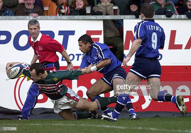 Austin Healey of Leicester Tigers is foiled by Jason Robinson of Sale during the Leicester Tigers v Sale Sharks Zurich Premiership match at Welford...
