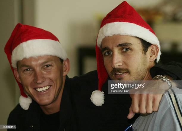 Brett Lee and Jason Gillespie of Australia get in the Christmas spirit at the Australian Team Christmas Lunch at Crown Casino Melbourne Australia...